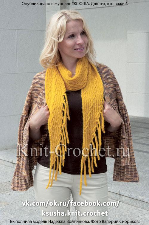 Связанный на спицах шарф с «кистями».