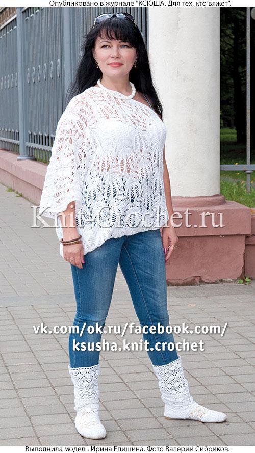 Женский пуловер со скосом размера 46-48, связанный на спицах.