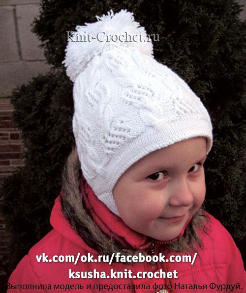 Зимняя теплая шапочка для девочки размера 52.