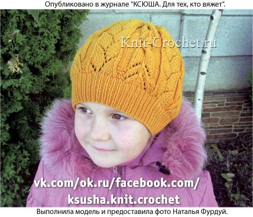 Шапочка для девочки (размер 57 см), вязанная на спицах.